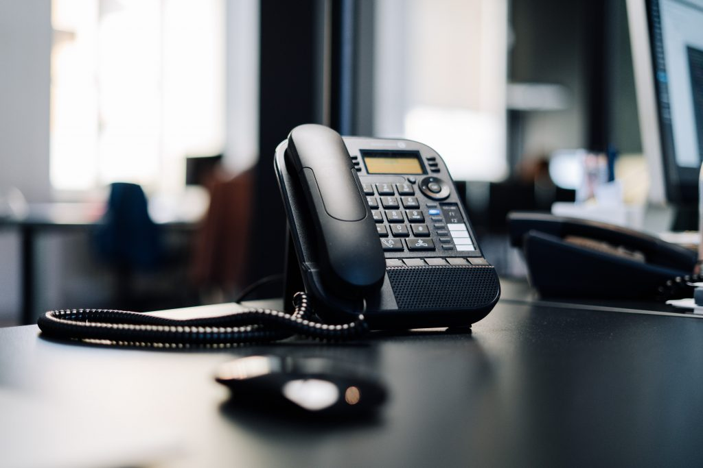 VoIP phone on a desktop - part of a VoIP phone system for business